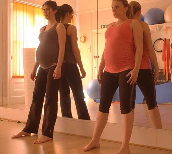 Pregnancy Pilates wall slides