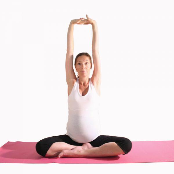 Pregnancy yoga shoulder loosening pose