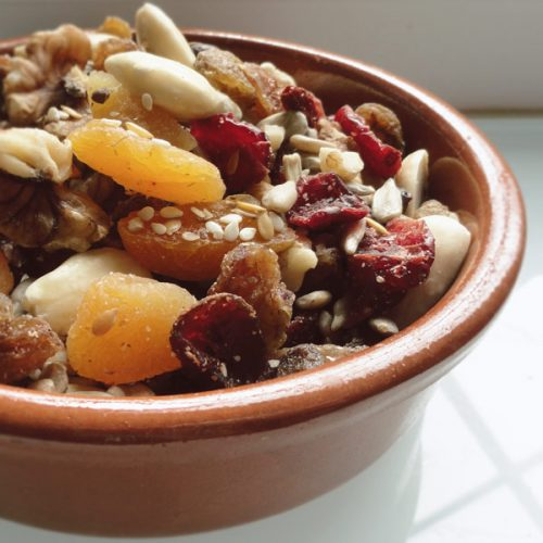 trail-mix with nuts fruit and seeds for a healthy snack after or before a pregnancy workout